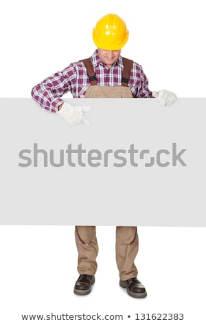 Male construction worker holding blank advertising board stock photo © photography33