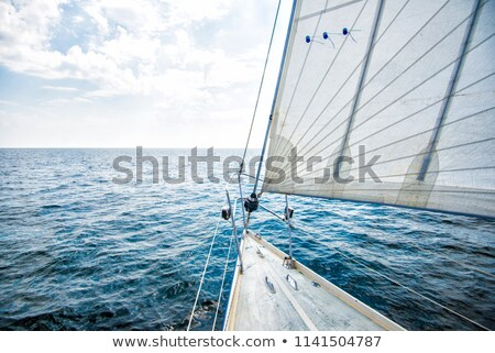 marine rope and winch over wooden deck stock photo © lunamarina
