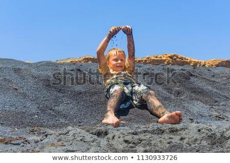 boys have fun at the black volcanic beach Stock photo © meinzahn