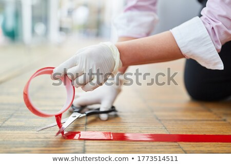 Businesswoman With Danger Tapes Stock photo © Voysla