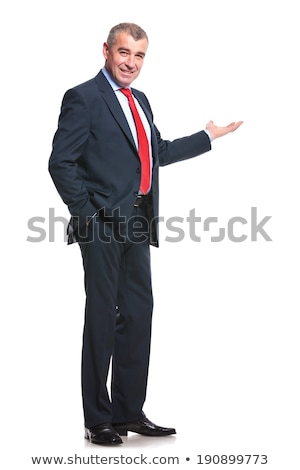 business man holding his hands in pocket while smiling stock photo © feedough
