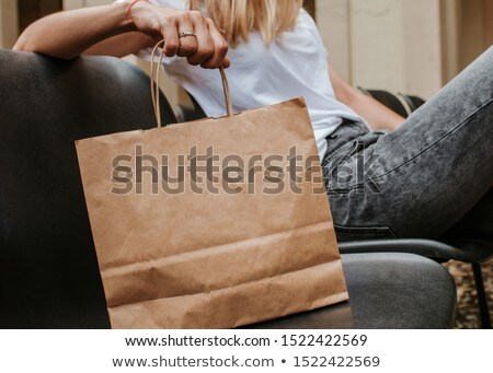 Happy blonde with paper bags Stock photo © Paha_L