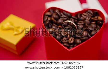 Coffee beans and red heart in an open box Stock photo © CaptureLight