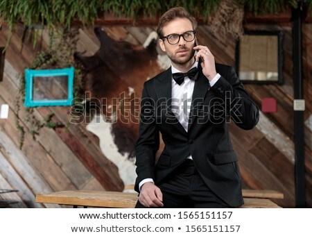 Szczęśliwy pan młody mówić telefonu młodych przystojny mężczyzna Zdjęcia stock © artfotodima