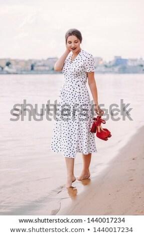 Attractive brunette in white polka-dot dress Stock photo © bezikus