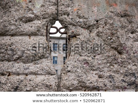 hole in the wall provides a look into on the other side Stock photo © Klinker