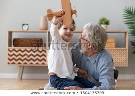 Happy boy playing with grandfather Stock photo © wavebreak_media