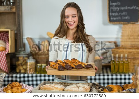 Croissants arranged on wooden tray at counter Stock photo © wavebreak_media