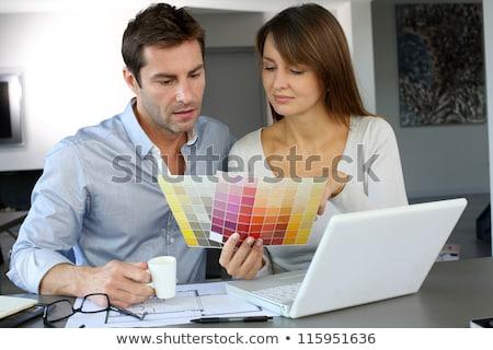 Couple choosing color from chart Stock photo © wavebreak_media