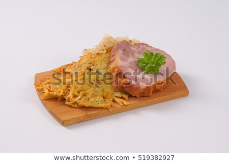 smoked pork with potato pancakes and sauerkraut Stock photo © Digifoodstock