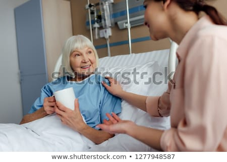 Mother and daughters with coffee in bed Stock photo © IS2