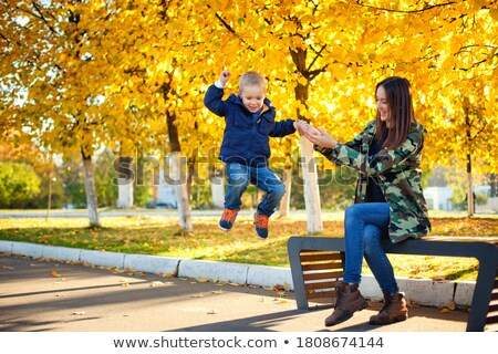 Children jumping off a bench Stock photo © IS2