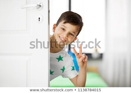 Boldog kicsi fiú mögött ajtó otthon Stock fotó © dolgachov