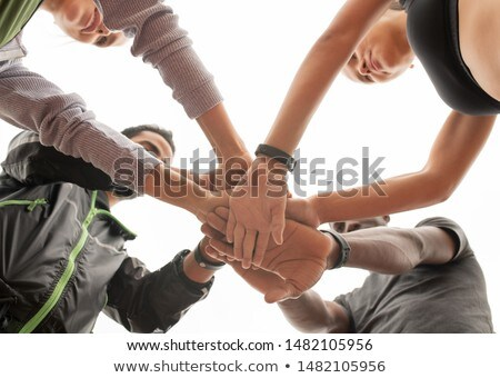 Below angle of young intercultural sporty people maing pile of hands Stock photo © pressmaster