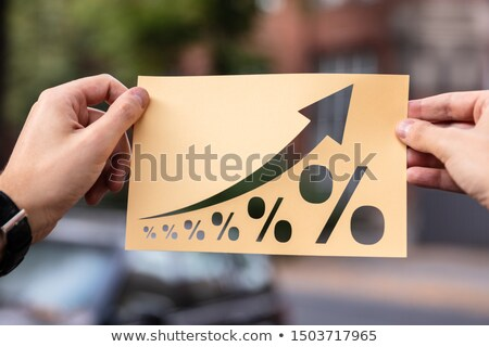 Hands Holding Paper With Cutout Percent Growth Stock photo © AndreyPopov