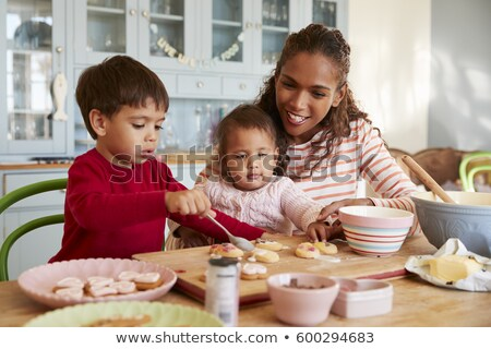 front view of african american girl baking cookies in kitchen at home stock photo © wavebreak_media