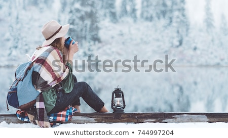 Stock photo: Woman with hot tea or coffee on a winter hike