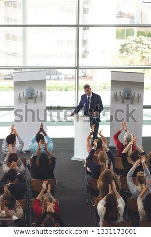 High angle view of diverse business people applauding while they are sitting in front of mixed race  Stock photo © wavebreak_media