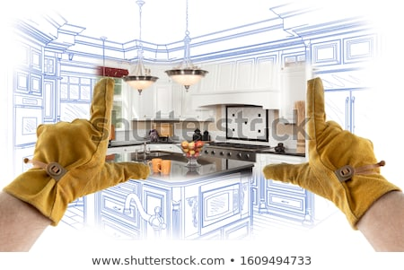 Male Contractor Hands Framing Unfinished Section of House Stock photo © feverpitch