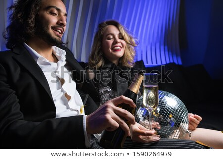 Felice giovane bottiglia champagne vino Foto d'archivio © pressmaster