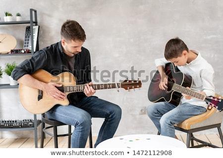 közelkép · zenész · gitár · zene · stúdió · hangszerek - stock fotó © morrbyte