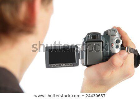 man with camcorder in hand from back stock photo © paha_l