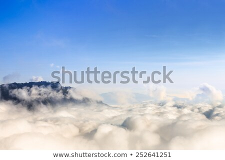 Fehér felhők fölött hegyek tenger tengeri kilátás Stock fotó © lypnyk2