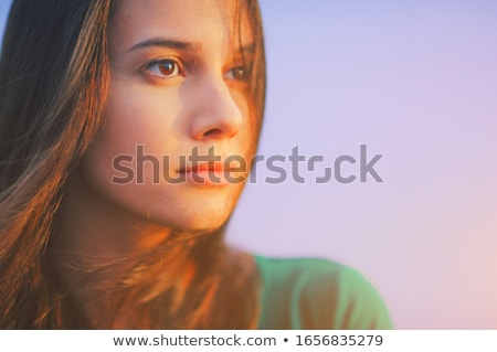 Happy young woman tanning in park summer sunshine Stock photo © darrinhenry