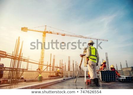 silhouet · bouwplaats · werknemers · steiger · zonsondergang · hemel - stockfoto © sifis