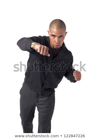 Clenched fist fight punch by young african man Stock photo © darrinhenry