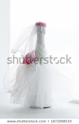 Stock photo: Wedding gown and decorated with white roses.
