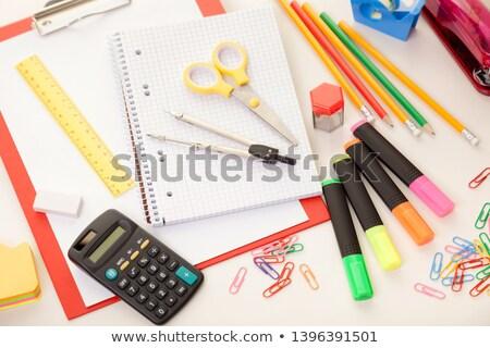 Pen, calculator and a ruler on notebook. Stock photo © borysshevchuk