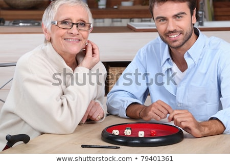 young man playing dice with older woman Stock photo © photography33