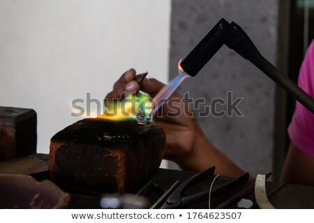 woman holding a blowtorch stock photo © photography33