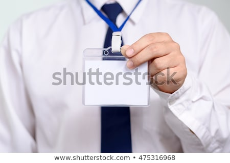 Businessman showing his card Stock photo © stockyimages