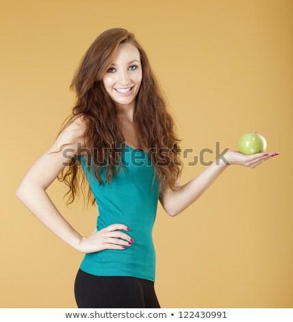 Single Green Apple In A Hand Of Woman Stock fotó © courtyardpix