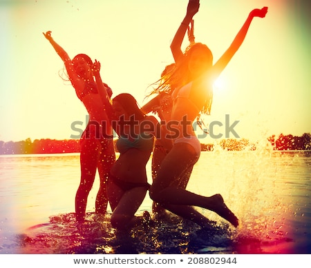 dancing happy girl on the beach stock photo © anna_om