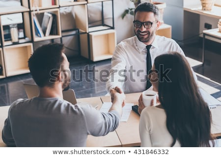 young couple meeting with an estate agent stock photo © photography33
