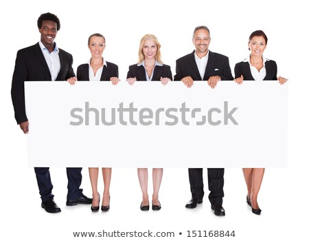 Female business professional holding blank billboard stock photo © stockyimages