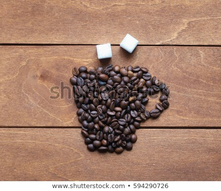 Grains of coffee on sugar granules Stock photo © alex_davydoff