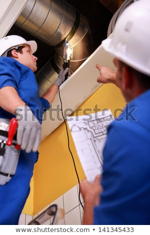 two workers inspecting ventilation system stock photo © photography33