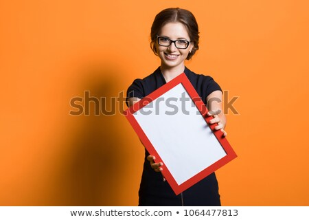Stock photo: young beautiful woman holding the frame of her glasses