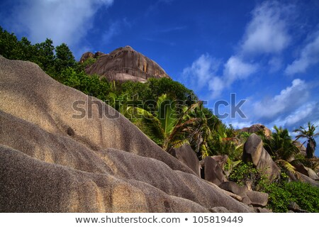 Large boulders weathered down with a terraced look Stock photo © chrascina