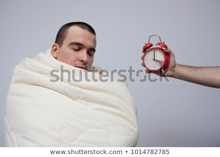 Young man suprised by alarm clock Stock photo © CandyboxPhoto