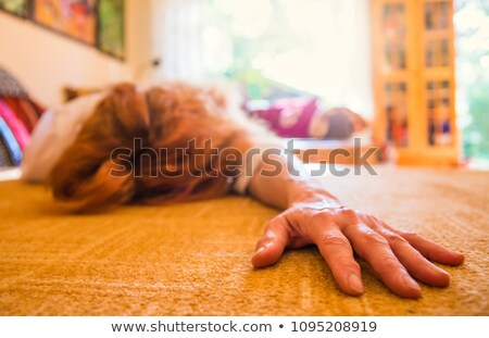 Woman lying unconscious on white background stock photo © pzaxe