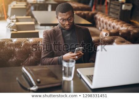 Fiatal üzletember imádkozik izolált fehér üzlet Stock fotó © feedough
