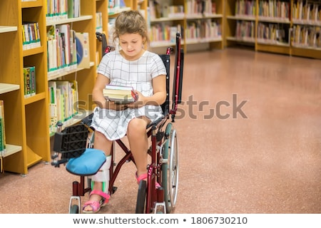 Stock photo: Blond little girl sitting on a wheelchair