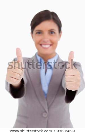 Thumbs up given by female entrepreneur against a white background stock photo © wavebreak_media