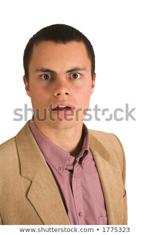 Businessman in a pink shirt and camel coloured jacket, looking surprised with his mouth open. Stock photo © Forgiss