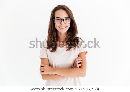 Brunette girl in glasses at white background. Stock photo © Massonforstock